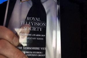 Julian Norton clutches the trophy during a successful night for The Yorkshire Vet at the Royal Television Society Awards.