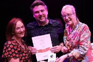 Jeanne Raspin and Neil White collect the award on behalf of Whitwell Players from Jacquie Stedman, the president of the National Operatic and Dramatic Association (East Midlands)..