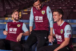 Charlie Taylor, Dwight McNeil and Ashley Westwood show off Burnley's new kit