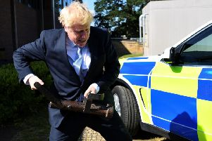Conservative party leadership candidate Boris Johnson holds a battering ram during a visit to the Thames Valley Police Training Centre in Reading, Berkshire, on Wednesday. He cancelled a promised interview with The Yorkshire Post.