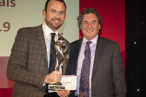 Director of Operations Shaun Curran (left) receives the award from Chris Baker, CEO of Capita Software.