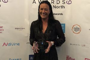 Golf club owner Fame Tate with her award.