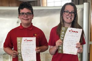 Proud Alfy and Freya with their 'independent traveller' awards