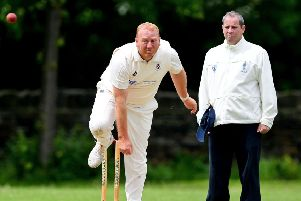 James Stansfield claimed 3-48 as Moorlands defeated Delph and Dobcross to move back into second place in the Drakes Huddersfield League Premiership last Saturday. Picture: Paul Butterfield