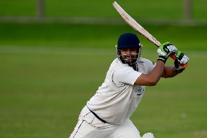 Kashif Talib scored 115 and followed up by taking 4-13 as Batley beat Pudsey Congs to reach the Priestley Shield semi-final.