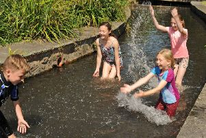 Children playing in water.