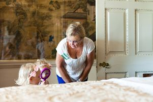 Exploring with a magnifying glass. � National Trust Images / Megan Taylor.