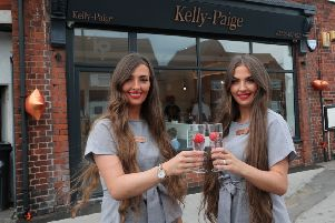 Kelly and Paige Stevenson celebrate opening of their new salon.