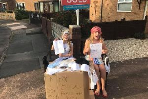 Immi and Esme selling mum's pants on the street