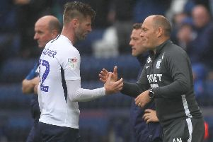 Paul Gallagher is congratulated by PNE boss Alex Neil