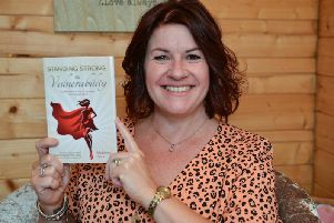 Madeleine Slack with her new book. Picture by Rachel Atkins.