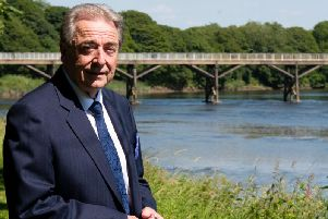 Keith Iddon, cabinet member for Highways and Transport and deputy leader of Lancashire County Council in front of the old Tram Road Bridge in Avenham Park, Preston.