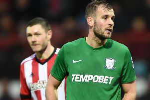 Tommy Spurr in action for Preston against Brentford at Griffin Park in February 2018