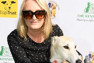 Ms Platt is seen here with rescue dog Pam
