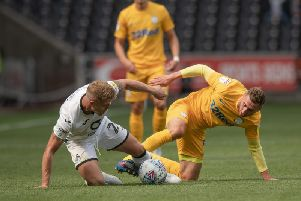 Preston striker Louis Moult tussles for possession with Swansea's Jake Bidwell