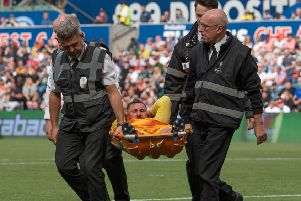 Louis Moult is stretchered off with a knee injury