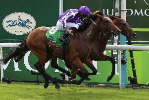Japan and Ryan Moore (near side) got the better of Crystal Ocean in a thrilling renewal to the Juddmonte International.