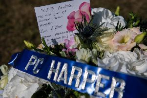 """""""Let us still our busy hearts and minds as we remember our colleague."""" (Getty Images)"""