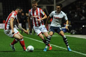 Josh Harrop come sunder pressure from Stoke City's Tom Edwards and Sam Clucas