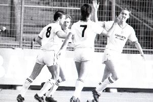 Tony Philliskirk (right) is congratulated by Bruan Mooney (No.7) and Tony Ellis (No.8) after opening the scoring against Brentford