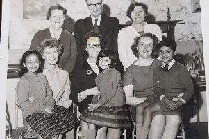 Shakila Kader (now Carter) far left sat on a teachers knee at The Parish Church School, in Preston'Mrs Williams is in the middle