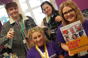 Participants are encouraged to create crazy hairstyles as a way of raising funds to support patient care.