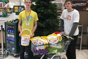 Will Bamford (left) collecting funds with his brother George for Galloway's Society for the Blind at Morrisons in Leyland