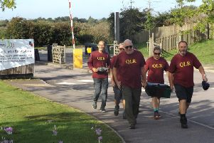 Former members of the Queens Lancashire Regiments carry a regimental time capsule, on foot, 130 miles from the QLRs traditional home in Fulwood Barracks, Preston to the National Arboretum, Alrewas, Staffordshire. They arrived on September 13, 2019, the anniversary of the Battle of Quebec, one of the regiments principal battle honours. Pictured, front left Colin Gifford; front right Steve Tranter; rear left Annette Lowton; rear right Nicola Partington; rear Dave Freeman