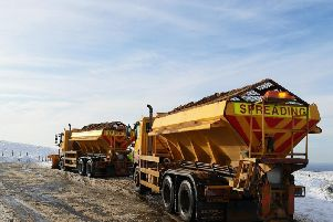 Gritters in action in snowy conditions