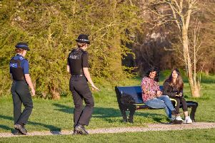 Avon and Somerset Police officers chat to people in a park in Bristol, where they are patrolling and enforcing the coronavirus lockdown rules. PA Photo. Picture date: Thursday March 26, 2020. Photo credit should read: Ben Birchall/PA Wire