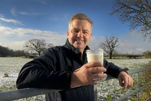Graham Young, North West Dairy Board Chairman, savours a pint of milk