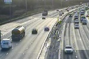 A broken down car is blocking a lane on the M6 between junctions 33 and 34 near Lancaster.