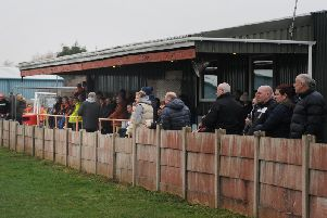 AFC Blackpool fans watch the on-the-field action at the club's Jepson Way ground.