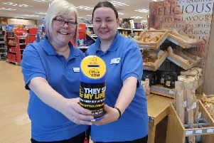 Helen Scase and Julie Smith with a collection tin for the Lincs & Notts Air Ambulance.