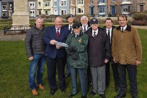 Councillor Allan Barclay (second from the left) looks at plans for the new path with (from left) Dawson Landscapes Managing Director Andrew Dawson and local Armed Forces veterans Ian Fraser, Dave Murray, Barry Fishburn, Chris Ward, Daniel Threadgill and Mike Facchini.