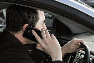 Police introduce detectors to stop drivers using mobile phones