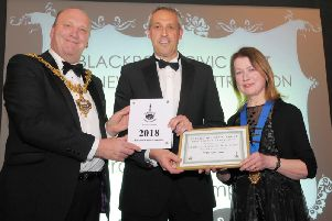 Blackpool Mayor Gary Coleman presents Darren Webster, boss of Blackpool Zoo, with their prize along with Joan Humble
