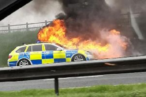 A police car has caught fire on the M6 between junctions 32 and 33 at Broughton. Credit - Sharron (@peapodlets)