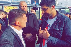 Tommy Robinson and a representative of the Light Foundation.
