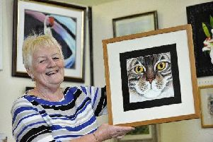 Kathryn Sey with her artwork, Bright Eyes, at one of South Ribble Artists' exhibitions in aid of MacMillan Cancer Trust at Hutton Village Hall.