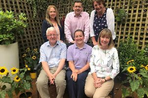 Back row: (From left) Dawn Andrews, David Robinson and Lynn Grayson, of Derian House Childrens Hospice'Front row: (From left) George Thomas, Trustee at LifeNow, Shelley Baron, Derians new Transition Support Worker, and Susan Witts, Trustee at LifeNow