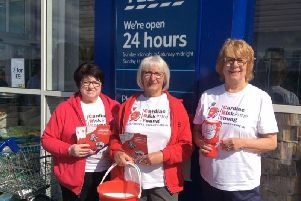 Sheila Wiggins, Ann Coles and Christine Abram raise money for CRY at Tesco, in Leyland