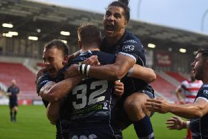 Featherstone Rovers' Ash Golding leaps on try-scorer Alex Sutcliffe after he scores one of his tries against Leigh Centurions.(PIC: DEC HAYES)