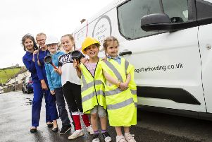 Little plumbers: Chantelle, Olivia, Mason, Georgia, Arianna and Rosie helped get Together Housing Group's message out to the public.