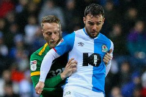 Preston skipper Tom Clarke challenges Blackburn striker Adam Armstrong at Ewood Park