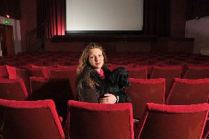 Palace Cinema owner Lara Hewitt with cinema dog Bruce