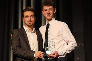 Rob Cotton collects his UK Young Rally Driver of the Year award