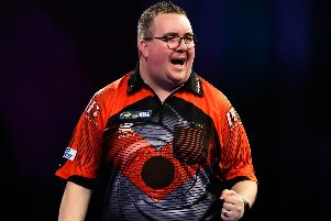 Stephen Bunting celebrates during his match against Luke Humphries before crashing out of the William Hill World Darts Championships at Alexandra Palace