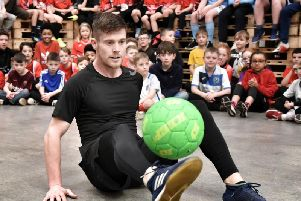 John Farnworth shows his skills to young footballers