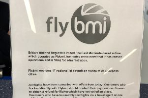 A notice at Bristol Airport informing passengers that flybmi flights have been cancelled following the collapse of the airline. Photo: PA Wire
